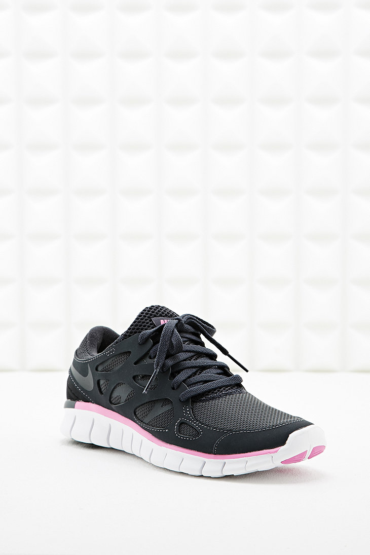 nike free run v2 trainers in black and pink urban outfitters