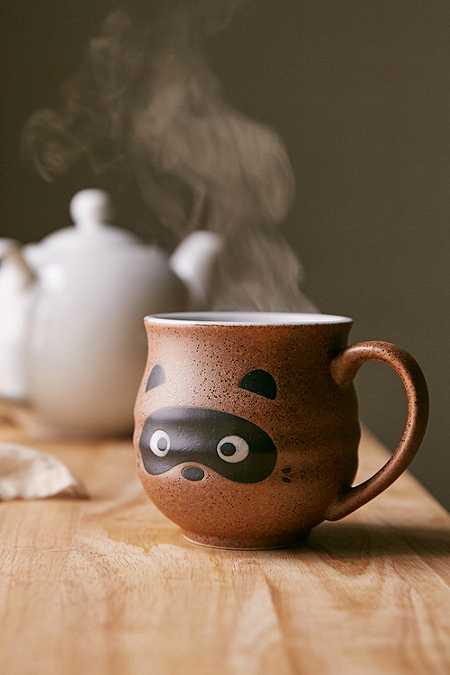 Tasse avec tête de raton laveur