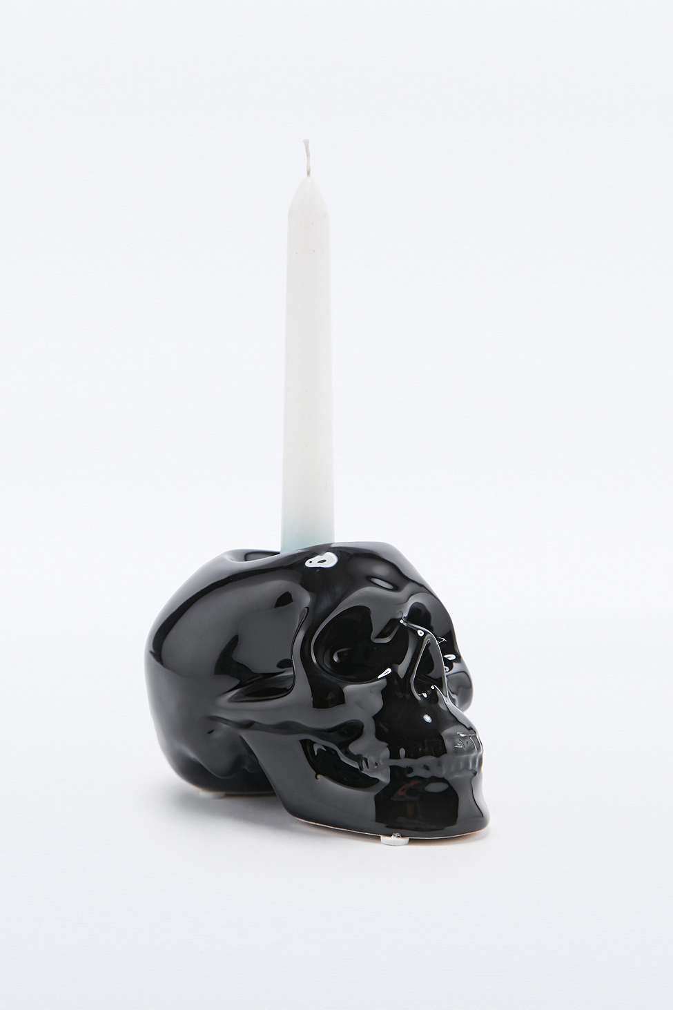 black skull candle holder Unique And Quirky Gift Ideas Any Odd Person Will Appreciate (Fun Gifts!)