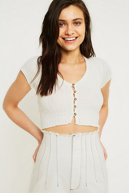 UO Embroidered Wrap Blouse. 55.00 €. White · UO Short-Sleeve Button-Through  T-Shirt