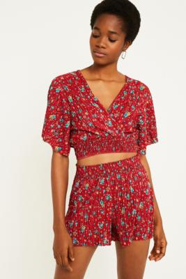 e2afd7c1 Shoptagr | Uo Red Floral Plisse Dolman Blouse by Urban Outfitters
