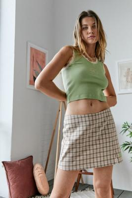 UO - Mini jupe fendue à carreaux - Urban Outfitters - Modalova