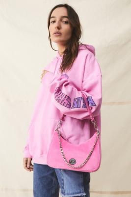 UO - Sac bandoulière en velours avec chaîne - Urban Outfitters - Modalova