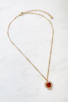 UO - Collier doré à pendentif caur en pierre - Urban Outfitters - Modalova