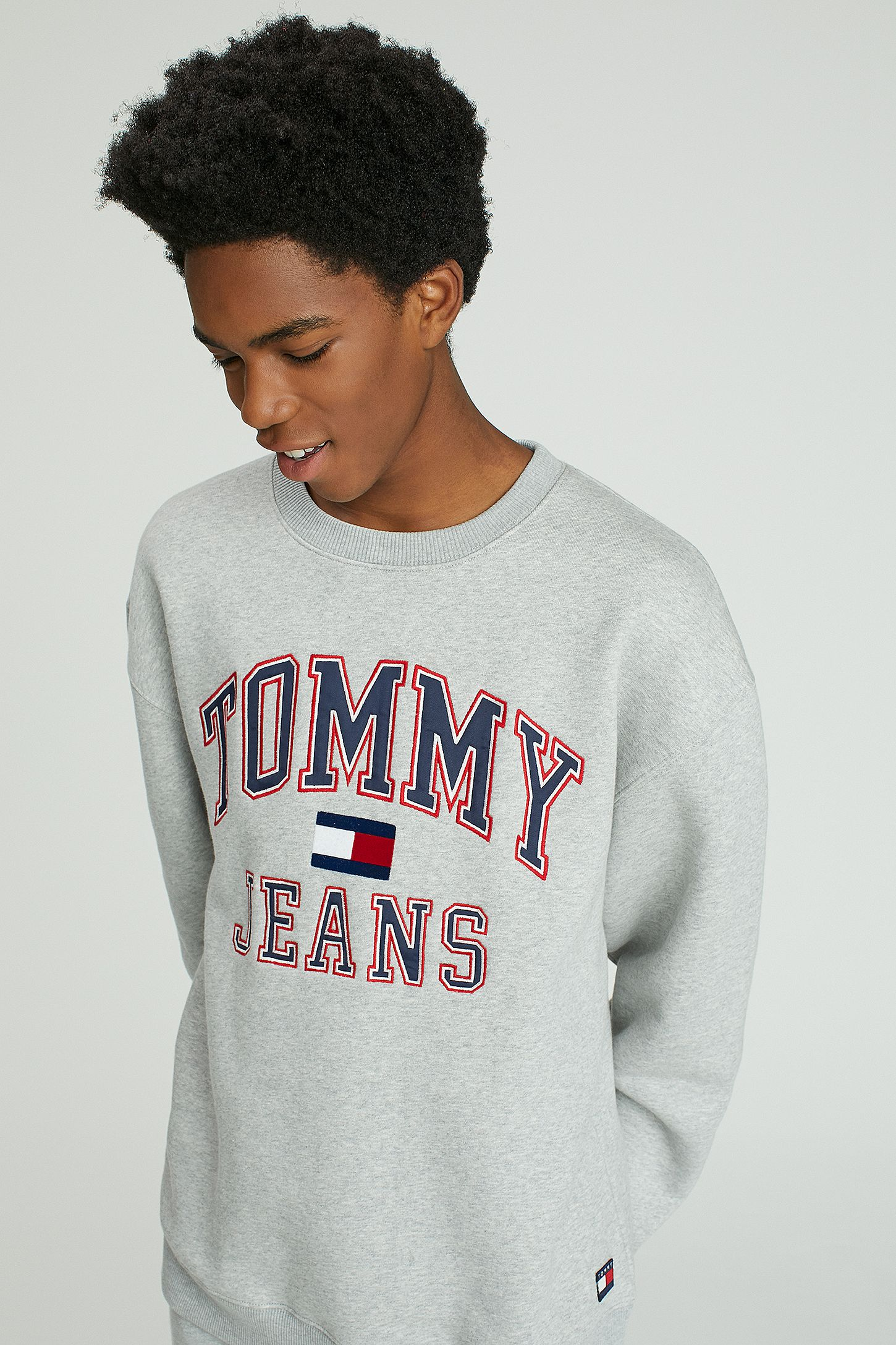 Tommy Jeans  90s Grey Marl Crewneck Sweatshirt. Click on image to zoom.  Hover to zoom. Double Tap to Zoom c6ec60efd8