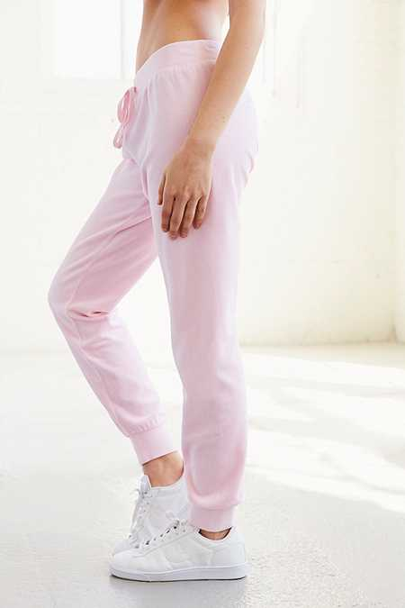Slide View: 5: Juicy Couture – High-Rise-Trainingshose aus Velours in Rosa mit Strasslogo