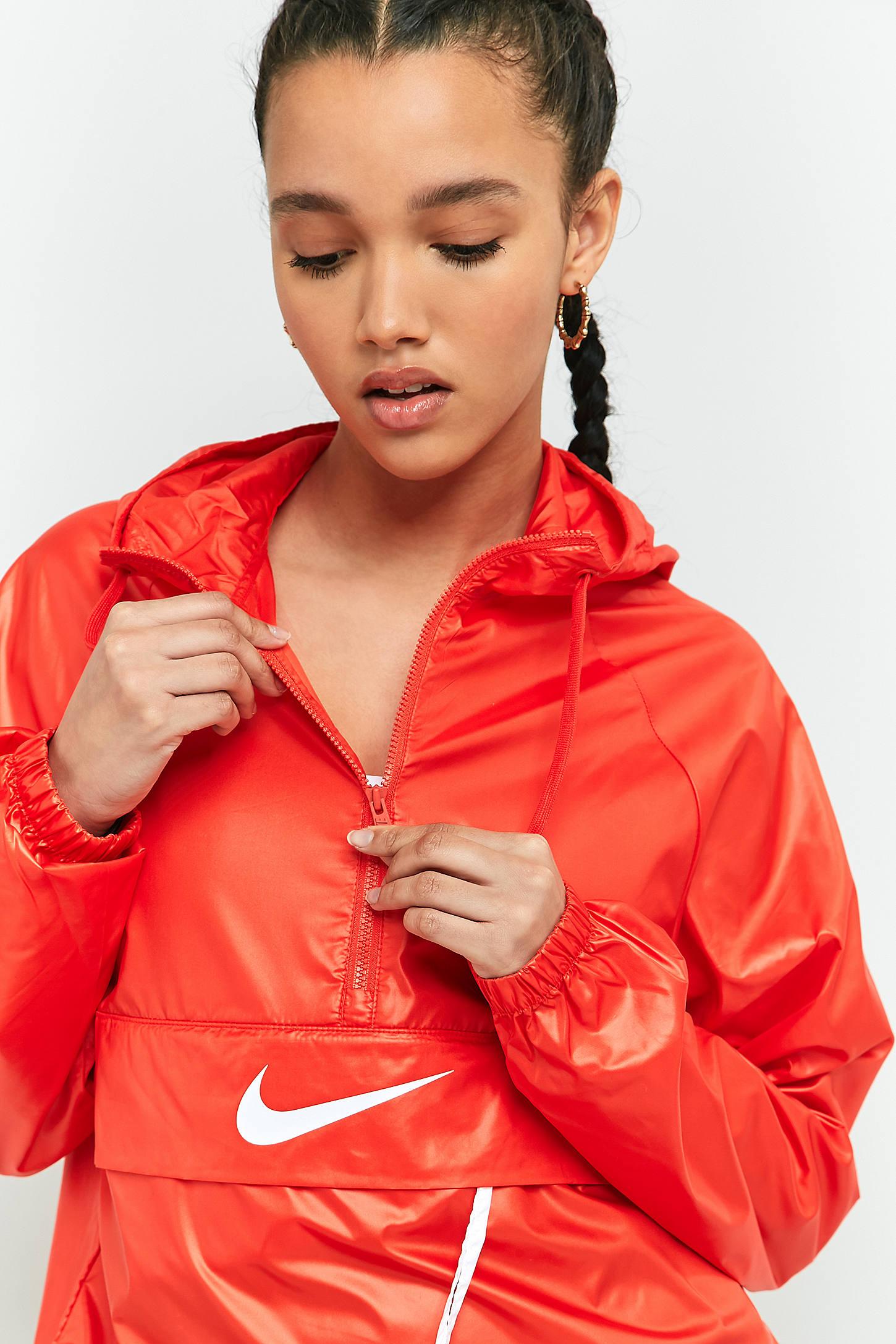 Slide View: 6: Nike Coupe vent rouge avec logo virgule et patte