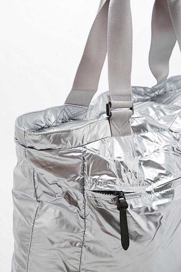 29055c46e74c Slide View  2  Nike Metallic London Tote Bag in Silver
